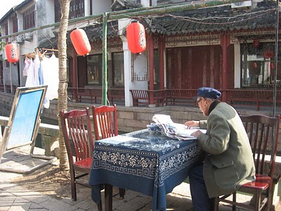 old man by the canal in tongli china
