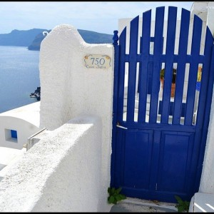 This vivid blue door amidst white walls is a common…